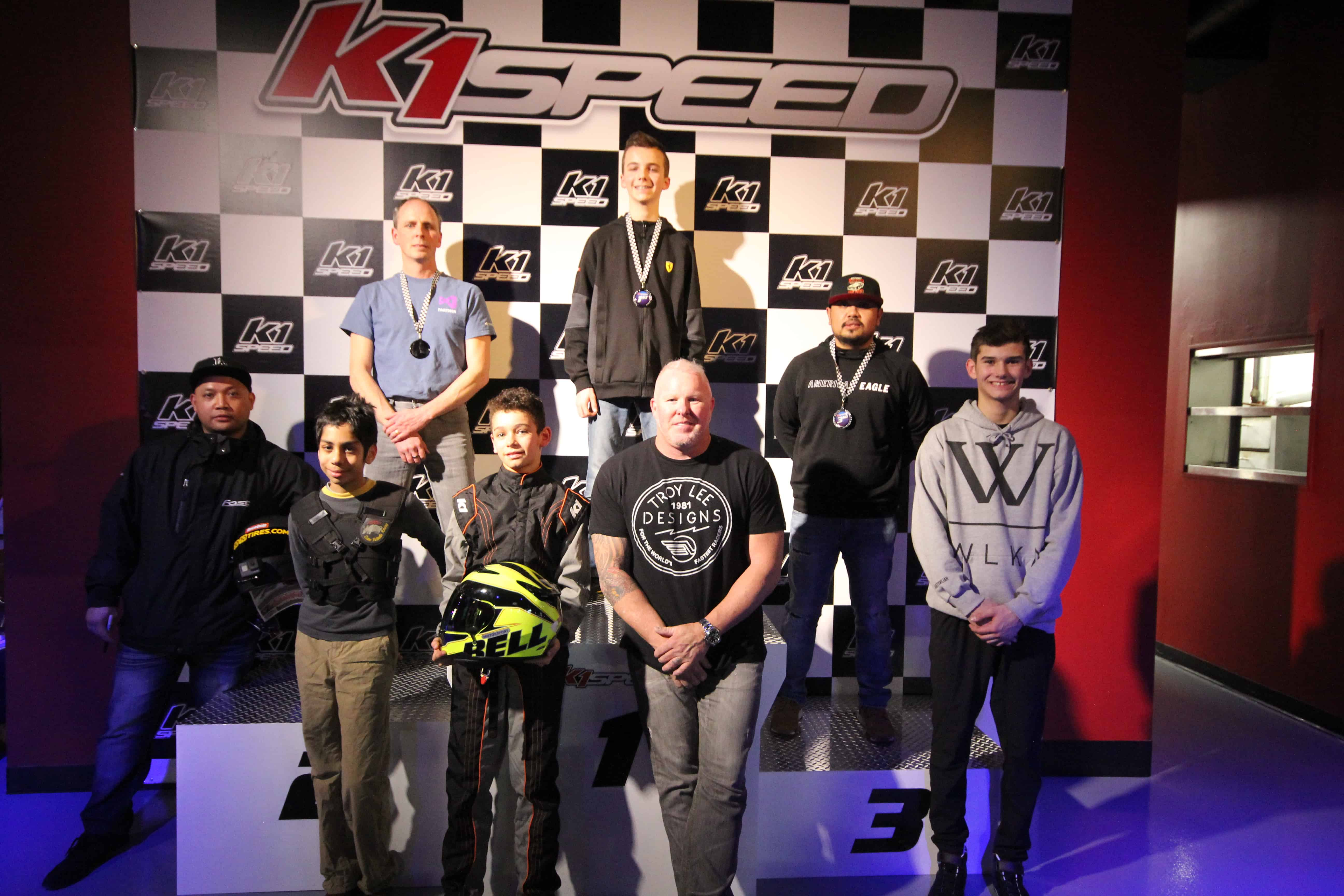 Paul Tracy at the podium with guests at K1 Speed Toronto