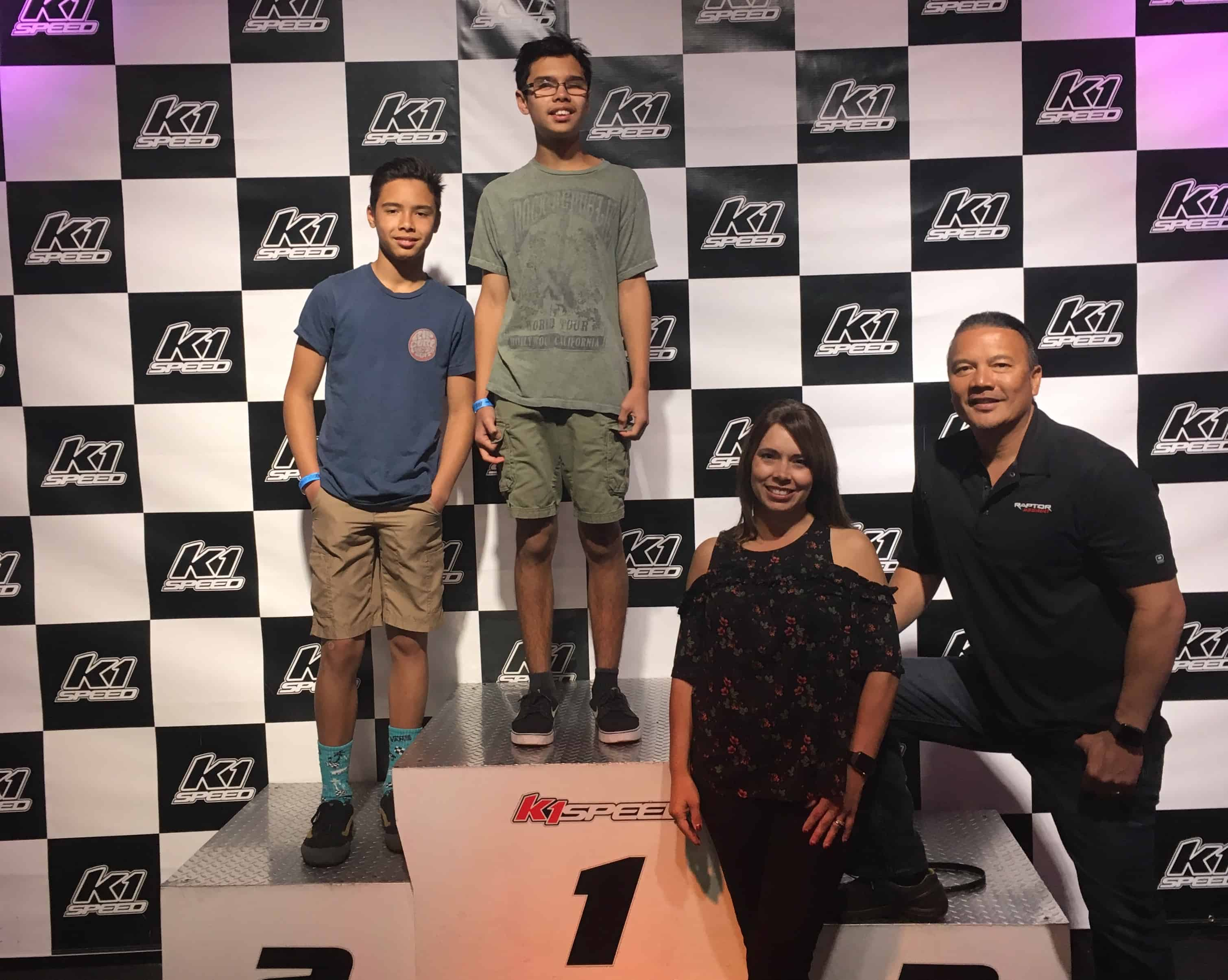 Christian with his brother, father, and mother on the podium at K1 Speed Irvine