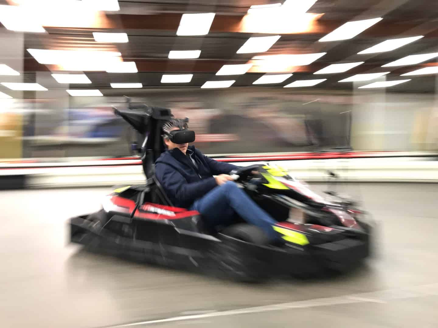 man races kart with vr equipment