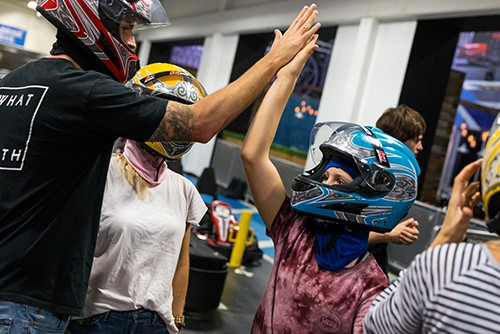 family high fives at a k1 speed during family fun day