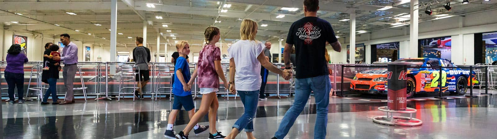 family walking into K1 Speed