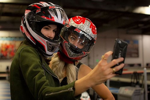 pictures of two girls taking a selfie at k1 speed
